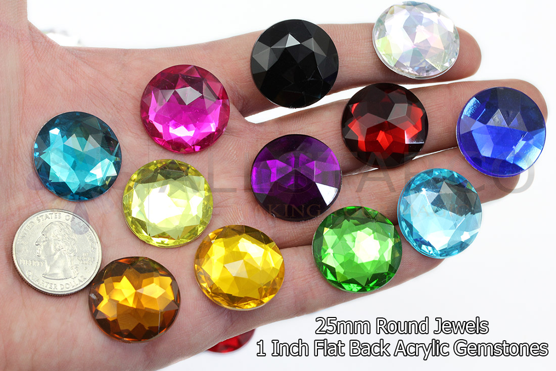 25mm acrylic round gems flat back on a hand with a quarter size reference