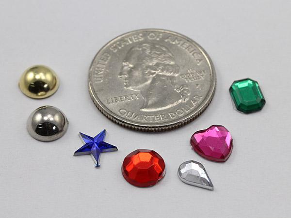 acrylic gems next to the quarter